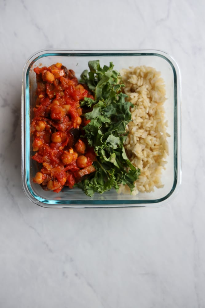 meal prep container with harissa chickpeas, kale and brown rice