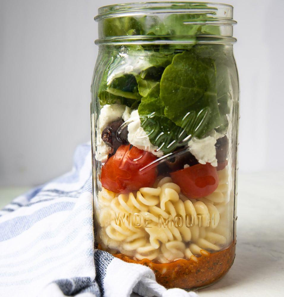 mason jar full of Romesco pasta salad