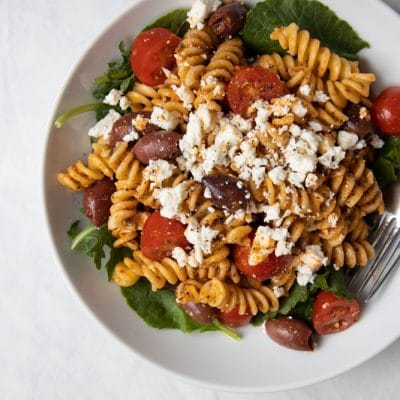 Red pepper pesto pasta salad in a bowl