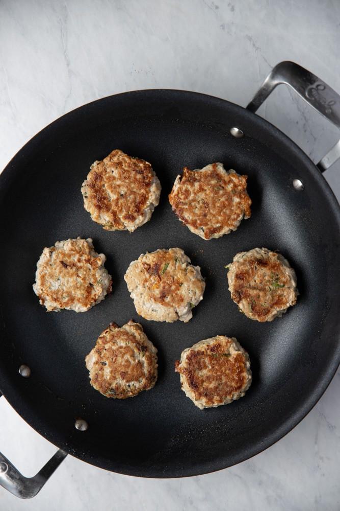 rosemary garlic turkey burger patties in a skillet