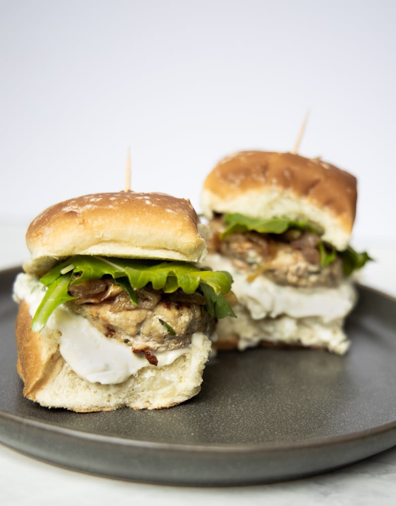 two juicy rosemary garlic turkey sliders on a plate