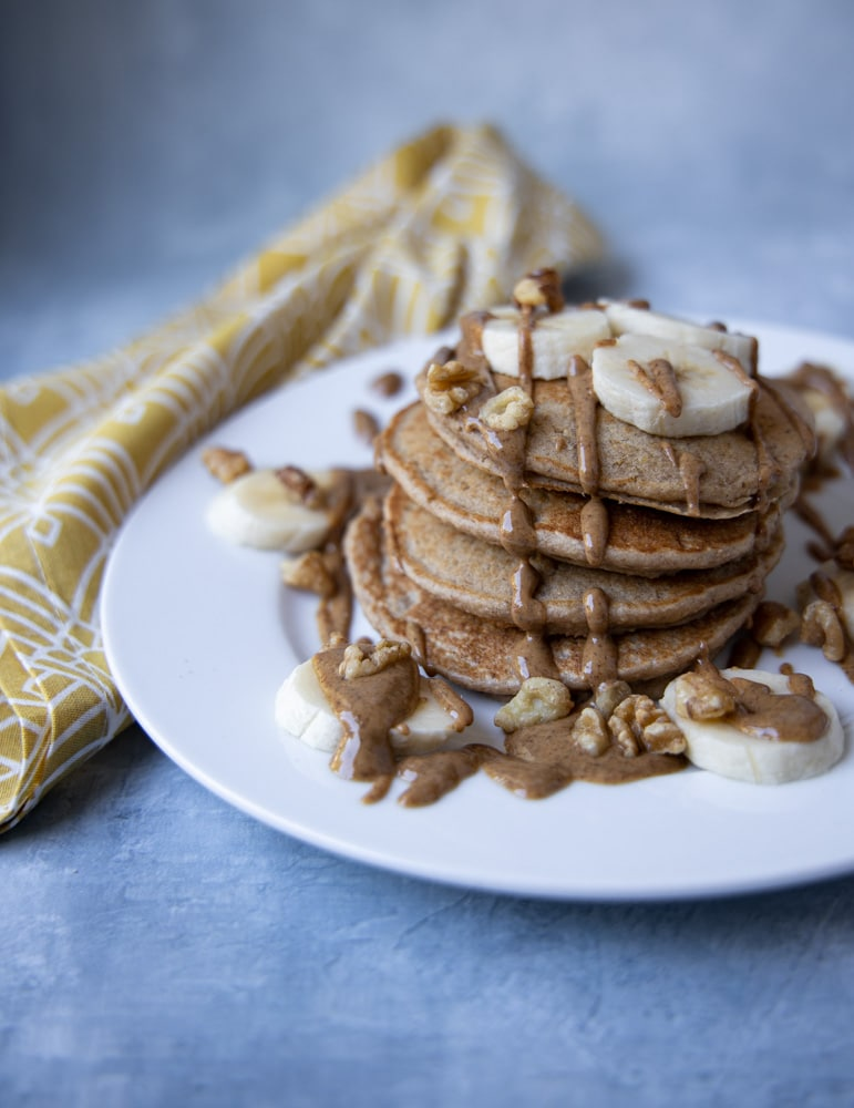 stack of banana pancakes on a plate