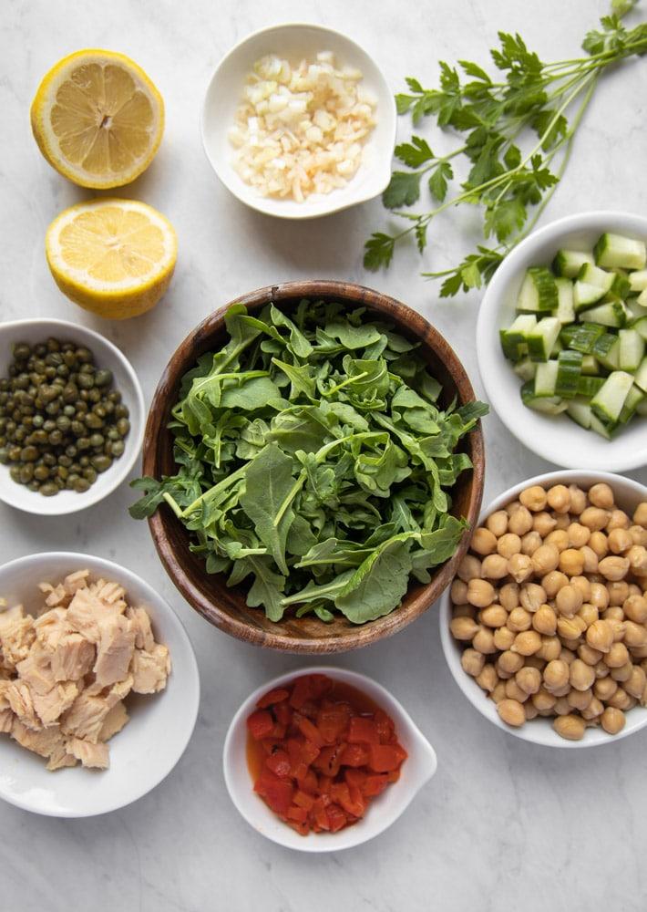ingredients for mediterranean tuna salad in individual bowls