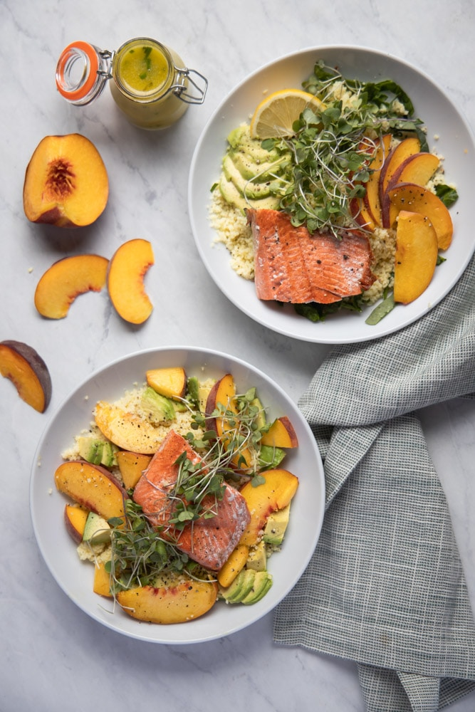 two salmon peach bowls on a table