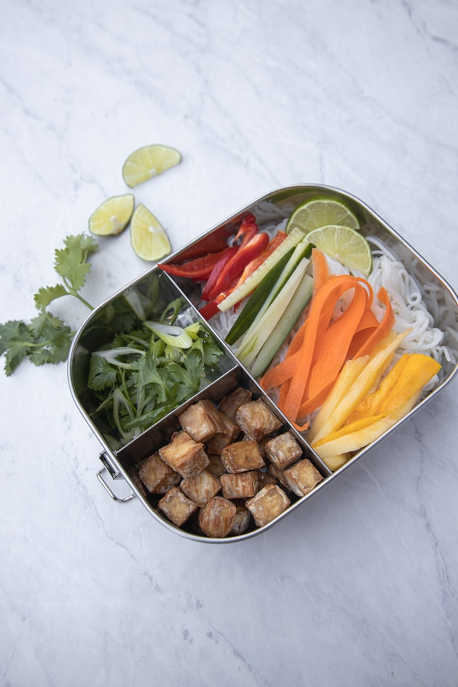 metal meal prep bento box with mango spring roll bowl inside