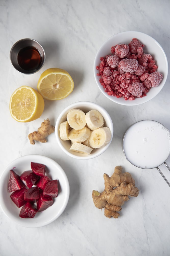 all the ingredients for the smoothie in individual bowls
