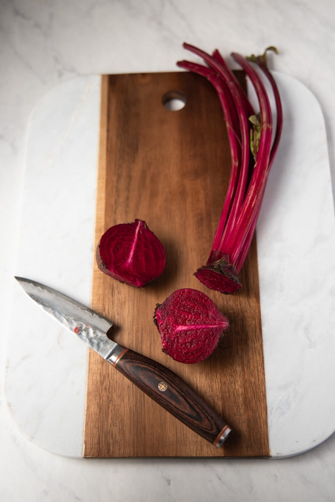 beets cut in half on a cutting board