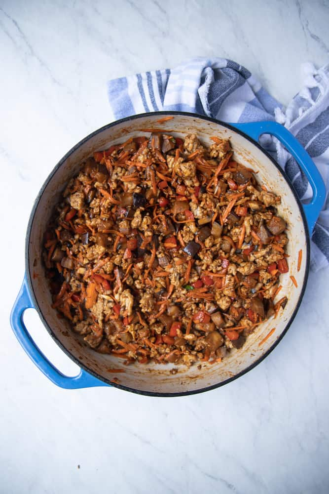 skillet filled with the cooked chicken and veggie mixture