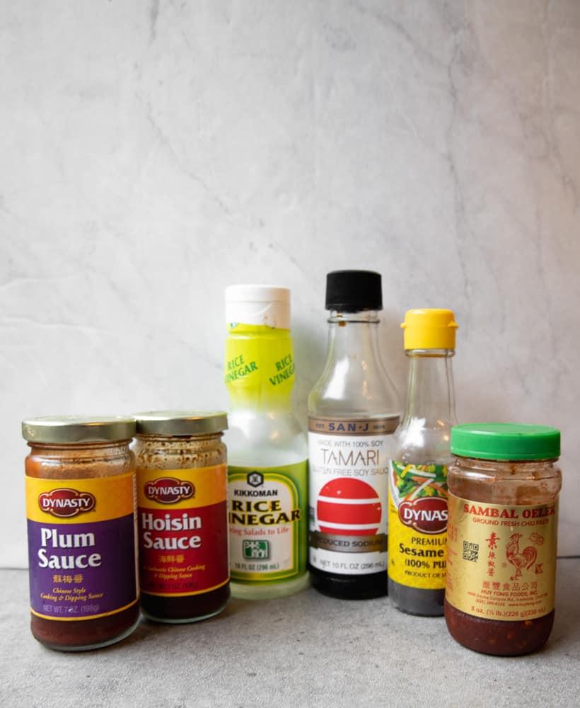 sauce ingredients for the lettuce wraps including soy, sesame oil, rice vinegar, plum sauce, hoisin sauce and sambal oelek