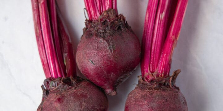 close up image of three red beets