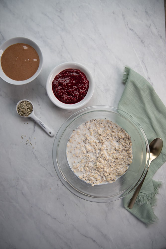 mixing bowls filled with ingredients for overnight oats
