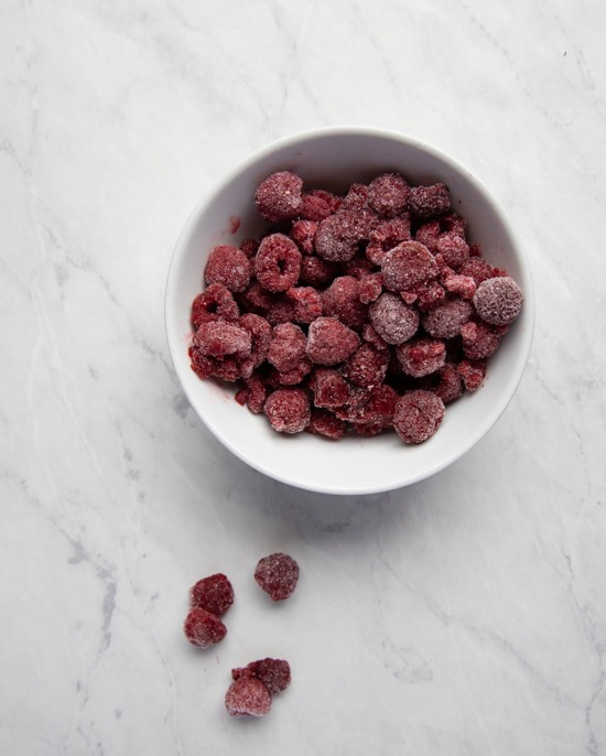 white bowl filled with frozen raspberries