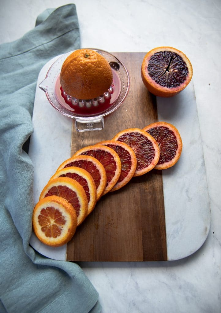 cutting board with blood oranges