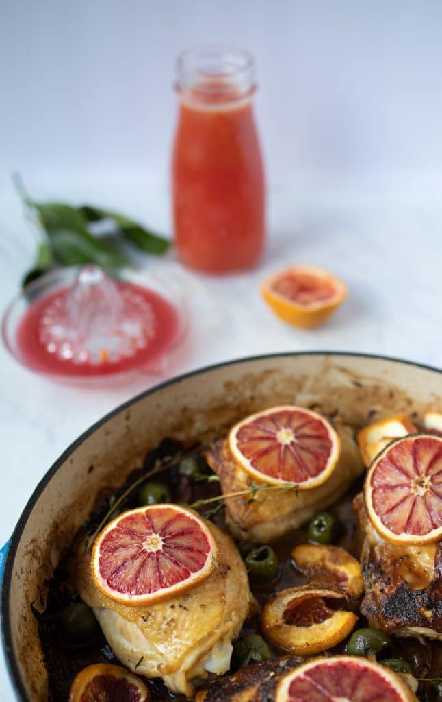 chicken thighs with blood oranges in a skillet