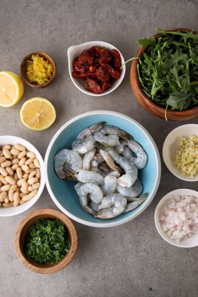 ingredients for the shrimp and bean salad in individual bowls