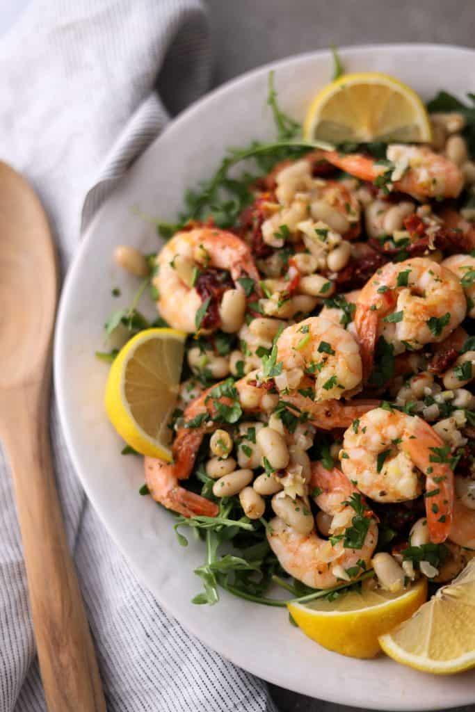 close up of shrimp and bean salad on platter