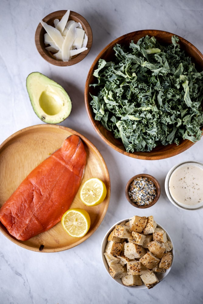 All the ingredients for the salmon Caesar salad in individual bowls