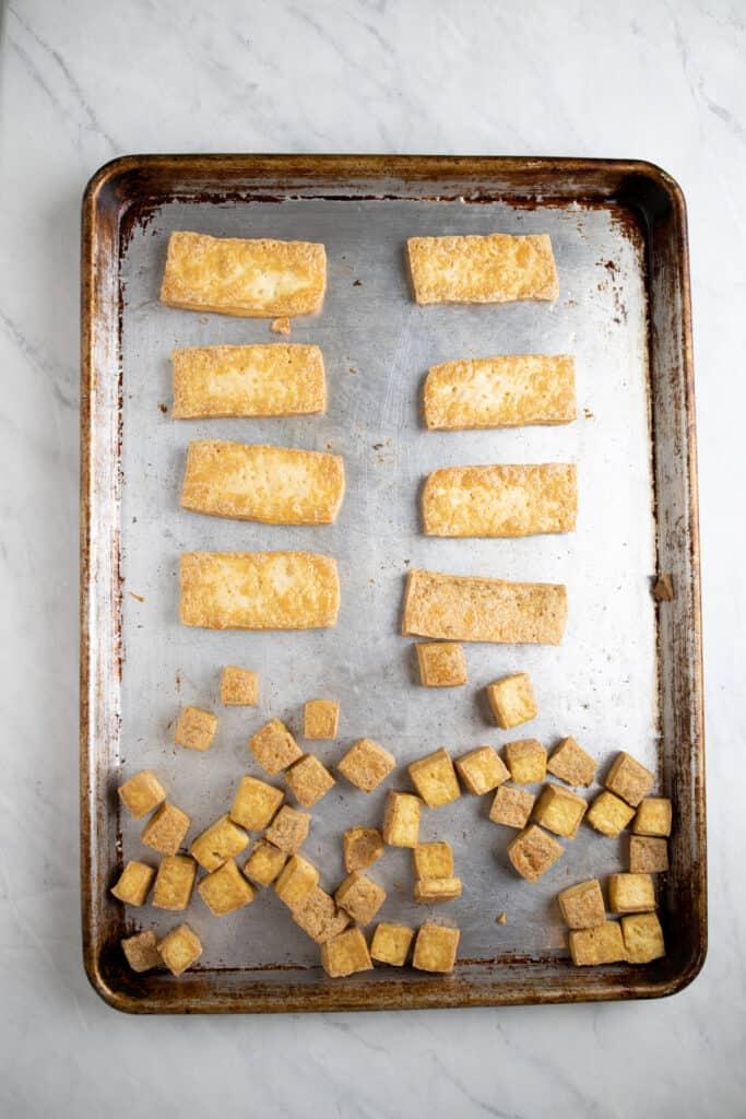 crispy tofu baked on a cookie sheet