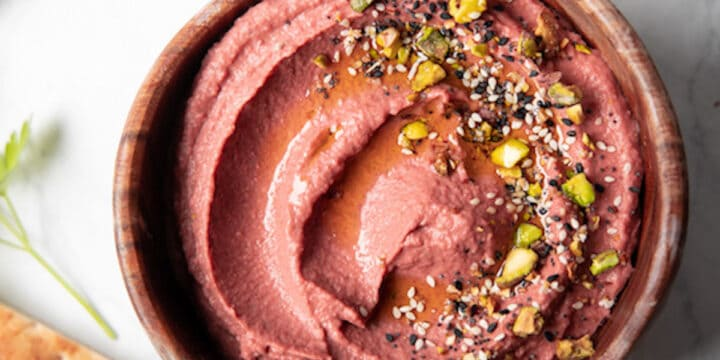 wooden bowl filled with lemon beet hummus