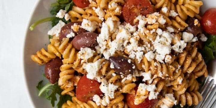 closeup image of bowl filled with romesco pasta salad