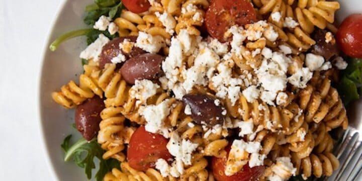 closeup image of bowl filled with romesco pasta salad
