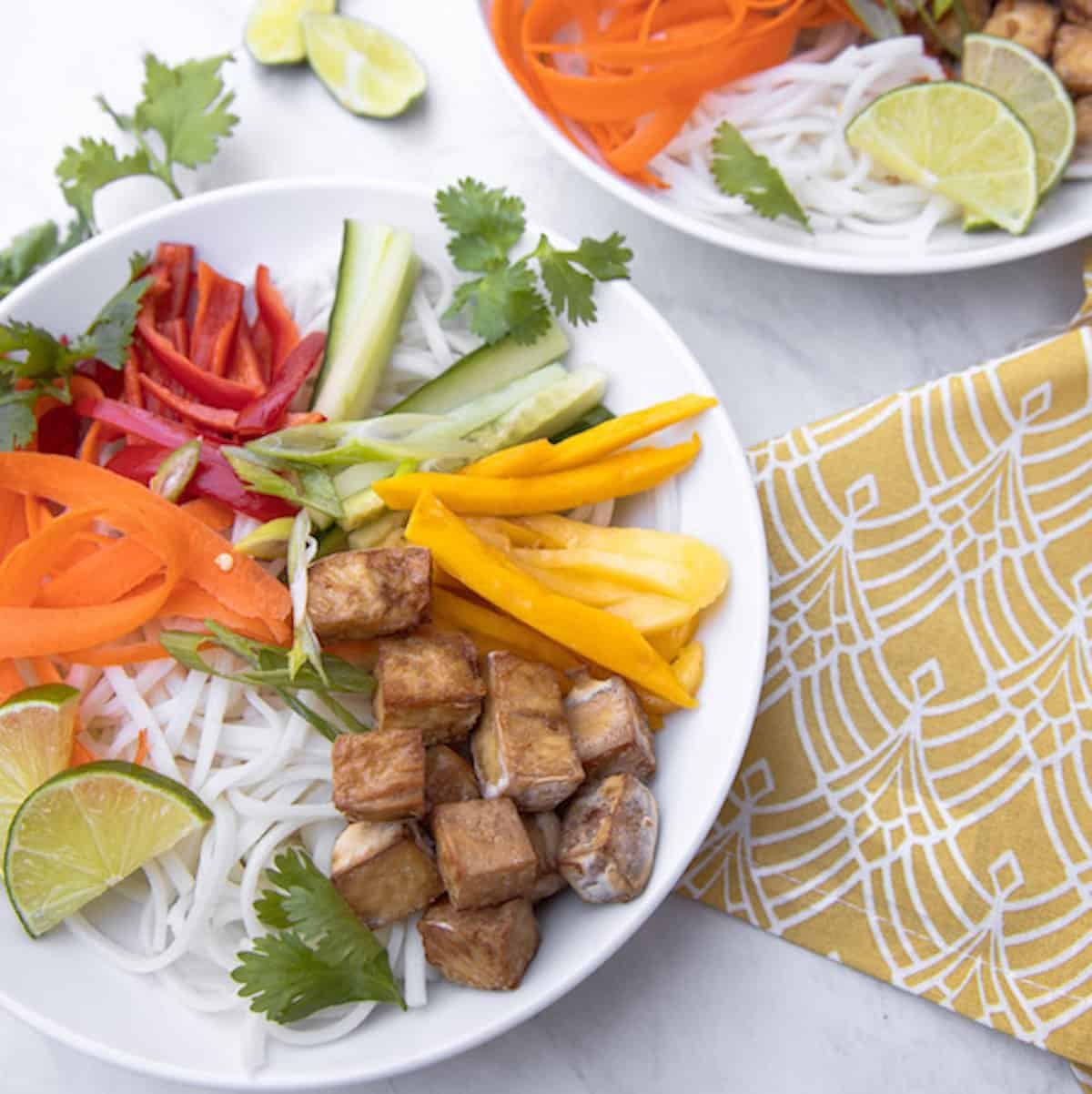 bowl of spring roll noodles, mango and crispy tofu