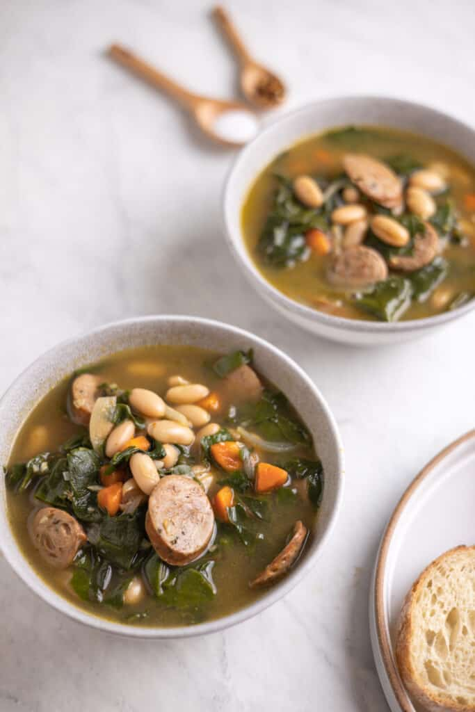 bowl of sausage, Swiss chard and white bean soup up close