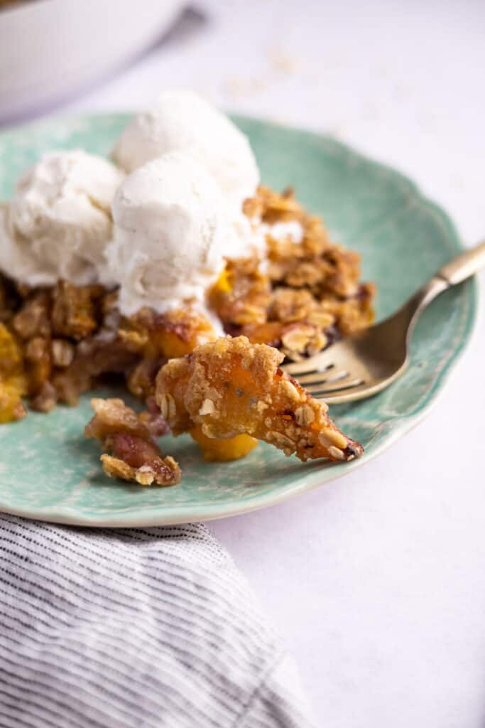 close up of nectarine crumble on a fork