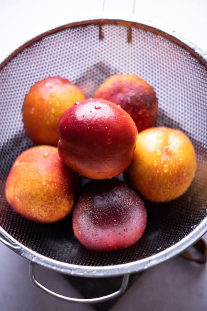 washed nectarines in a colander
