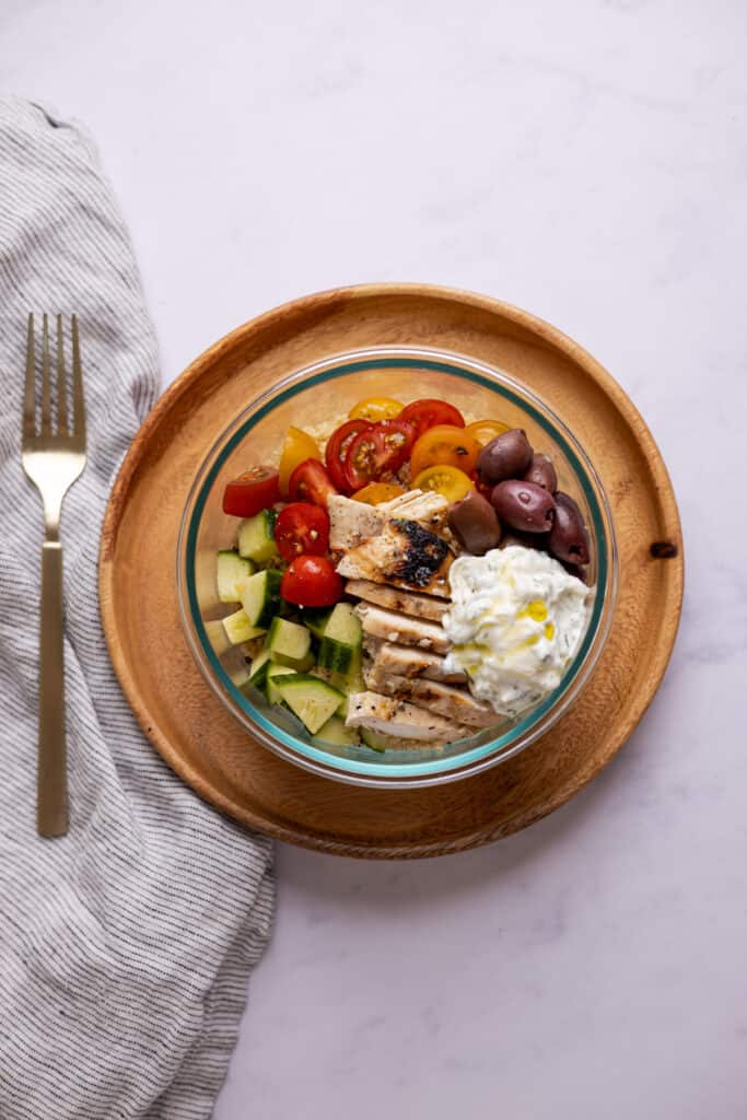 greek couscous bowl in a glass container
