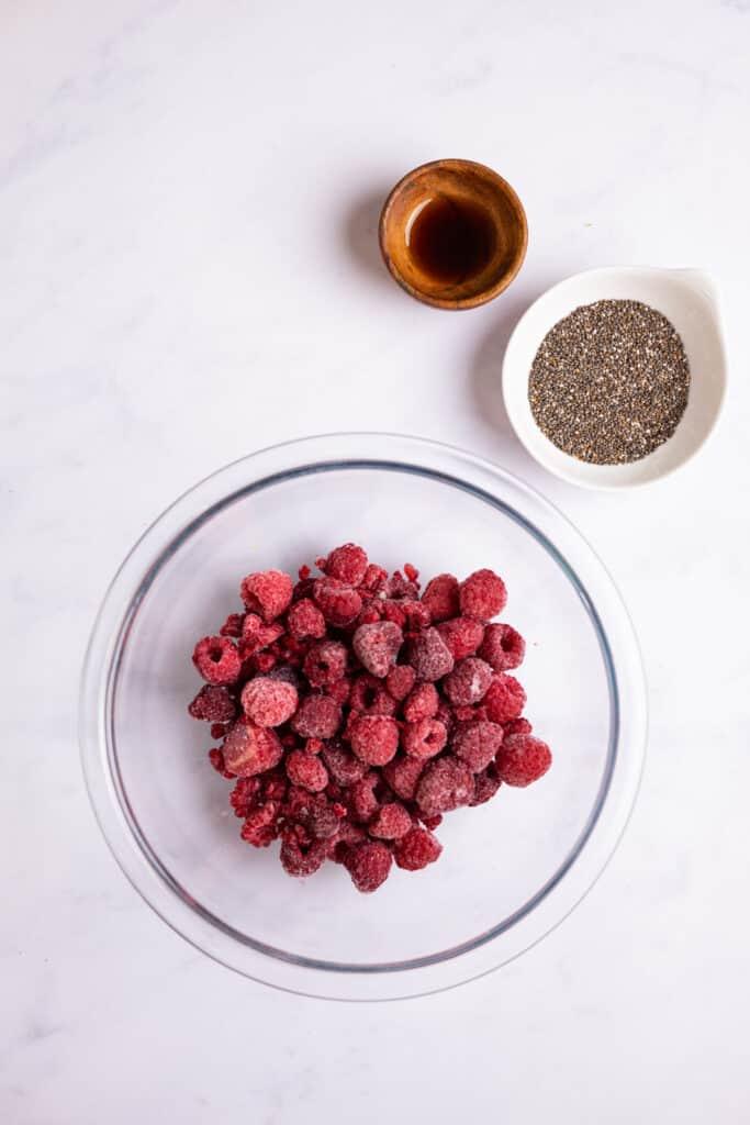frozen raspberries in a bowl